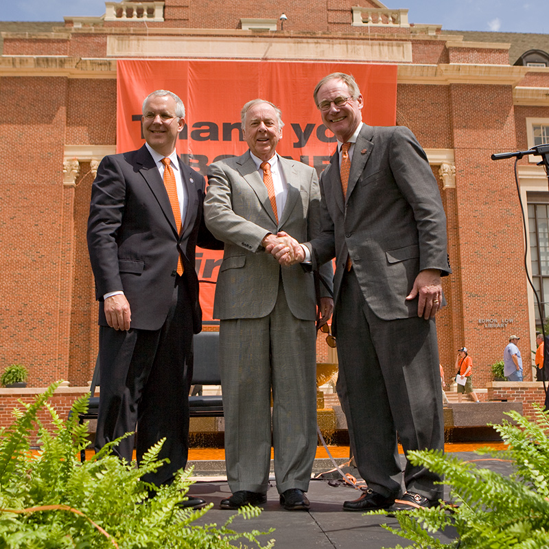 burns hargis shakes hand with Boone Pickens after gift announcement