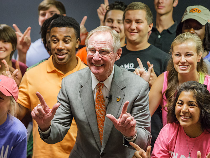 burns hargis and students gather for picture