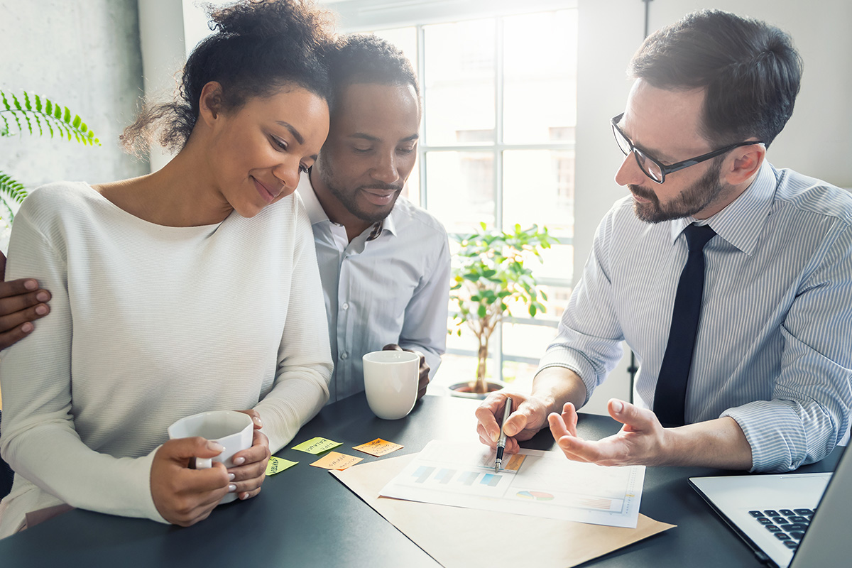 Financial planner working with clients