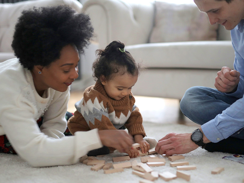 Parents playing with infant