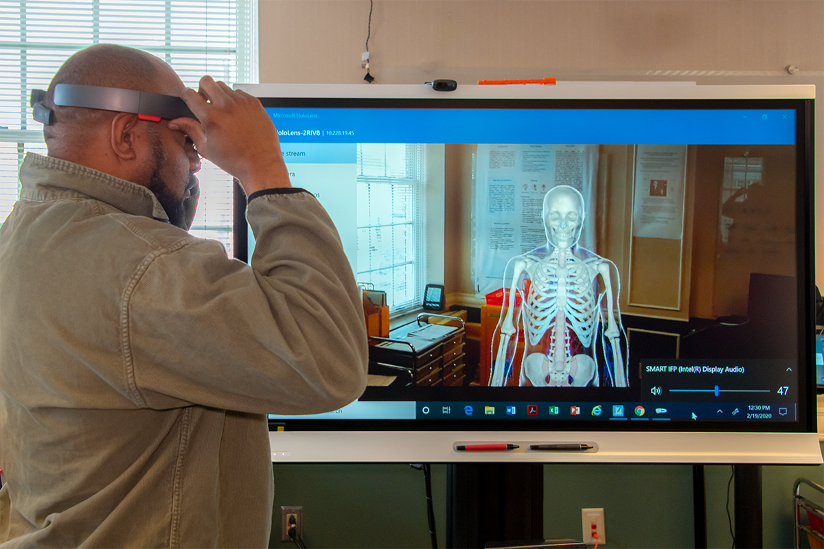 Student using augmented reality glasses