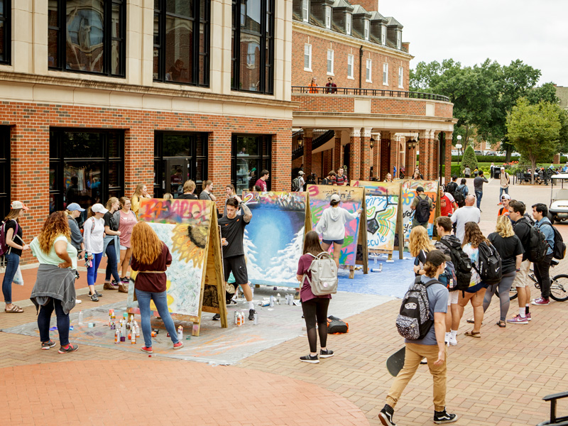 Students participating in an art project outside the Student Union