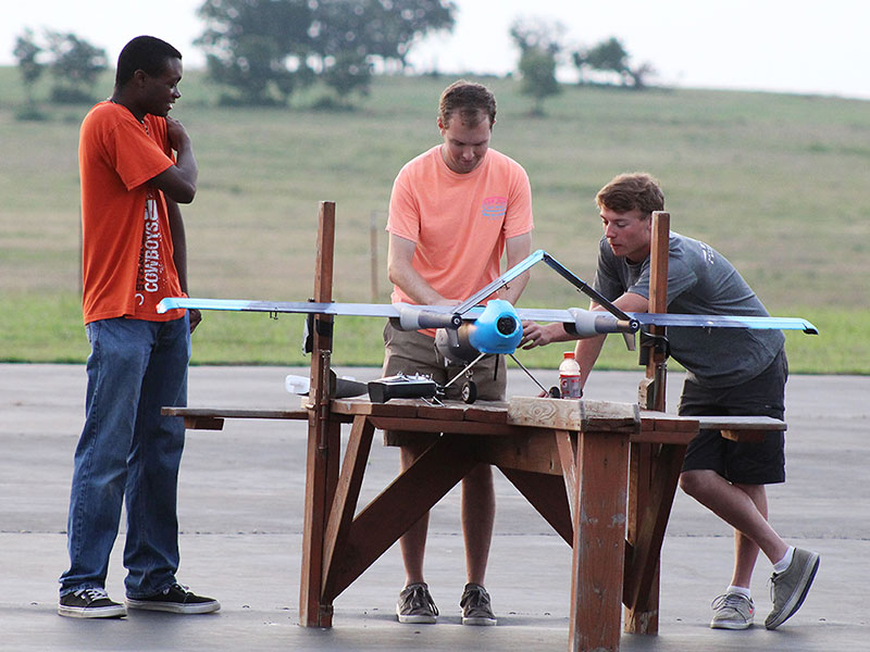 Students perform research with a drone.