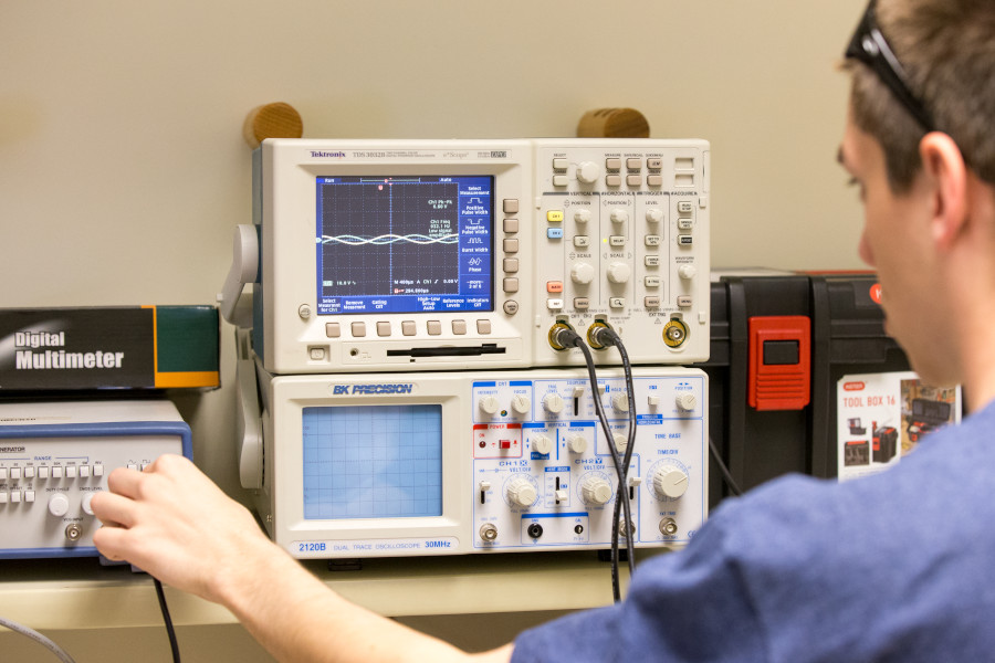 OSU student takes a reading using an oscilloscope