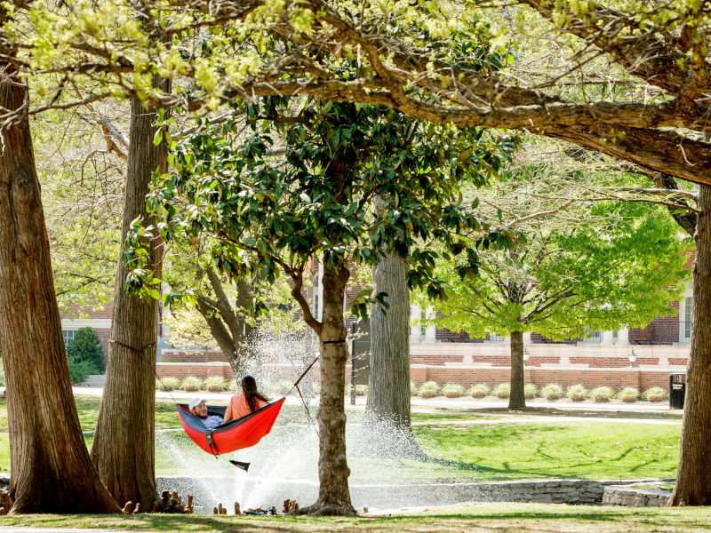 Student laying on hammock at OSU's Theta Pond