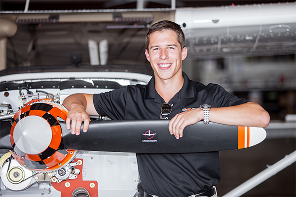 OSU student holding a propeller