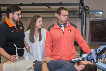 Students performing physical therapy on peer