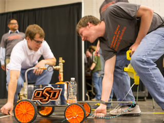 Two OSU students working in a chemical engineering competition