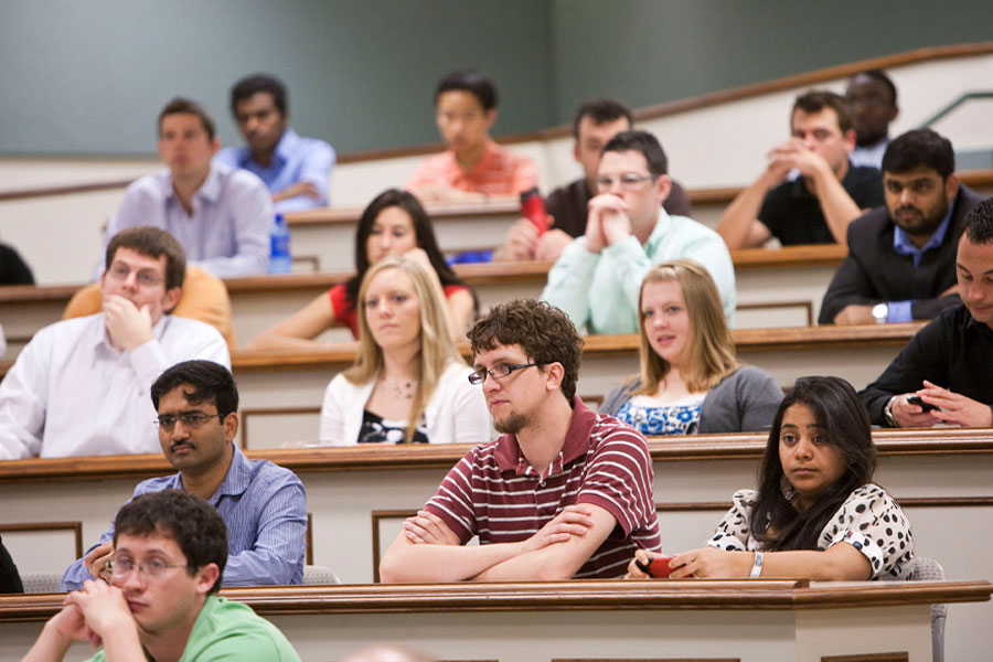 OSU economics students listening to a lecture