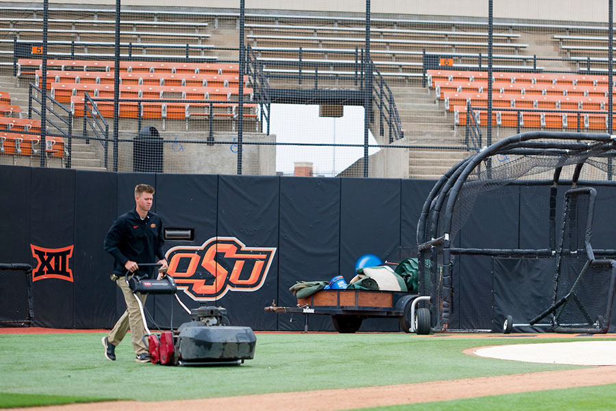 Student mowing turf at OSU's Allie P. Reynolds Stadium