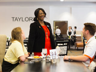 Student learning the ropes in the Taylors restaurant - an OSU exclusive restaurant